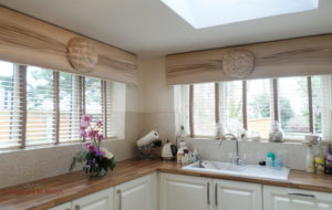 Kitchen windows with pelmets and matching faux wood blinds